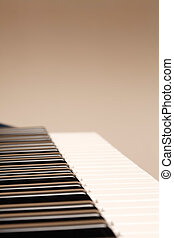 Keyboard with copyspace - Side view of a piano keyboard with...