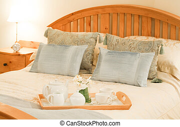 Hotel bedroom - Room service tray on a bed in a luxury hotel...
