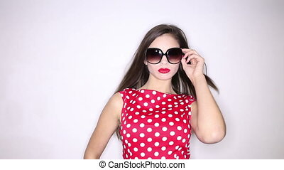 trendy woman - Beautiful young woman in red polka dots dress...