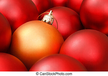 Christmas ornaments - Gold christmas bauble amongst red...