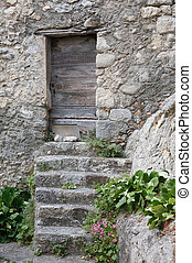 Stone house - Ancient stone house with steps and a wooden...