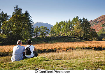 Couple enjoying view - A mixed race couple enjoy a scenic...