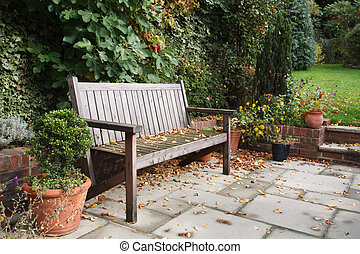 Garden bench in fall - Garden bench on a traditional...