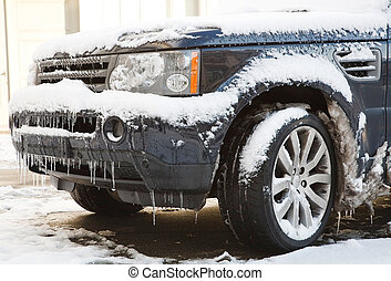 Winter driving - Snow and ice cover a 4x4 in freezing...