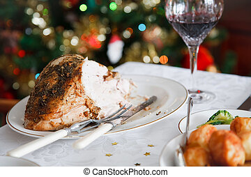Christmas meal - Roast turkey on a table in a festive...