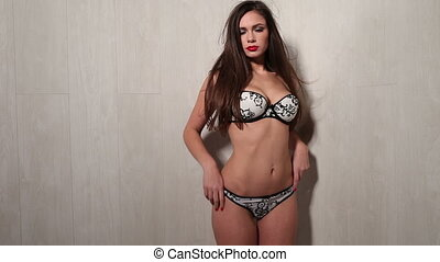 lingerie woman - Hot young woman in black and white lingerie...