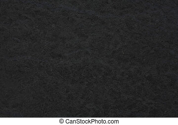Dark grey background with rough stone texture