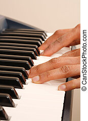 Pianist - Closeup of a womans hands playing a piano or...