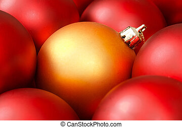 Christmas baubles - Golden christmas bauble surrounded by...