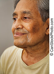 Indian senior citizen - Closeup portrait of an elderly...