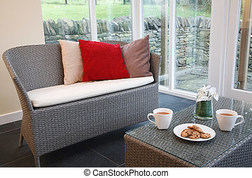 Rattan furniture in conservatory - Conservatory interior...