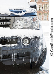 Car in winter - Closeup of a land rover covered in snow and...