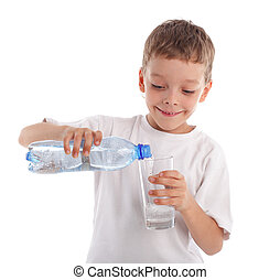 Child pouring water in a glass isolated on white