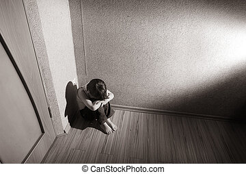 Childrens stress - Child sitting in a room corner