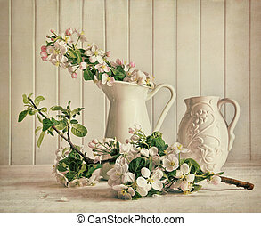 Still life of apple blossom flowers in vase on table
