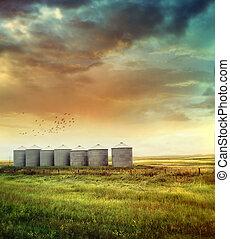 Prairie grain silos in late summer