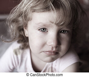 Sad child - Portrait of a beautiful little girl