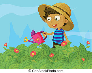 A boy watering the plants in a garden