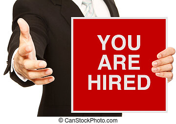 You Are Hired - A businessman offering a handshake and...