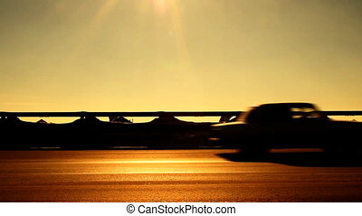 Silhouettes of cars on the highway.