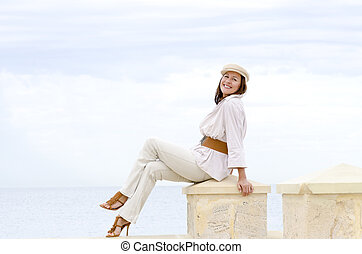 Attractive happy retired woman high heels beach - Portrait...