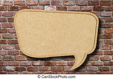Recycle paper speech bubble on old brick wall background