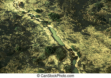 Aerial view of landscape in South Sudan - a pond, a dirt...