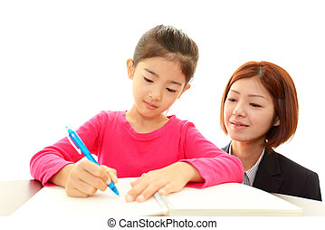 Young student studying with teacher