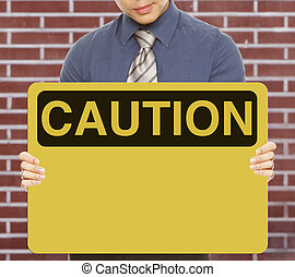 Blank Caution Sign - A man holding a blank caution or safety...