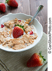 Breakfast cereals with milk and strawberries - Bowl with...