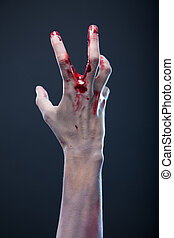 Bloody zombie hand, studio shot