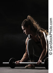 female bodybuilder - Young woman lifting weights