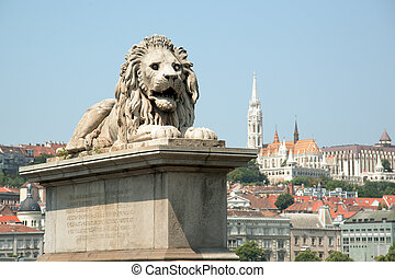 Budapest cityscape - Guardian lion statue with Buda view,...