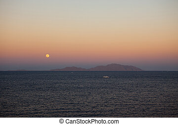 Moonrise over Tiran island in the Red sea
