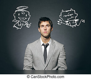 Angel and devil - Business man confused with his good and...