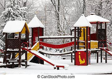 Children playground on snow blizzard in public park