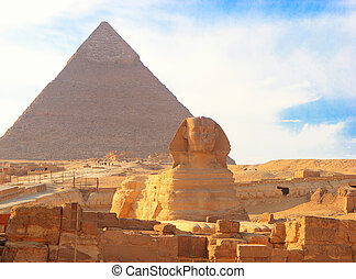 Great Sphinx of Giza against the Great Pyramid, Giza, Egypt.