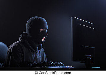 Hacker stealing data - Computer hacker - Male thief stealing...
