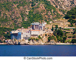 The holy monastery of Gregoriou, eastern view, Mounth Athos,...