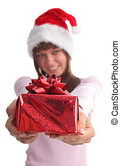 Woman in a Christmas cap with a gift