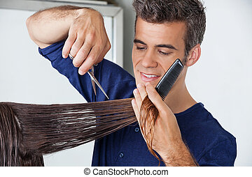 Hairdresser Cutting Client's Hair - Male hairdresser cutting...