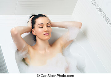 bathroom - beautiful girl lying in the bathroom