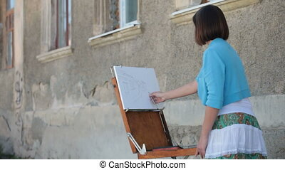 street painter drawing - street artist drawing sketch of the...