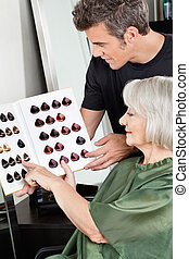Client And Hairdresser Selecting Hair Color - Female client...