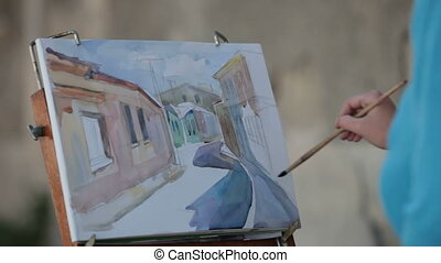 hand drawing in watercolor urban st - womans hand drawing in...