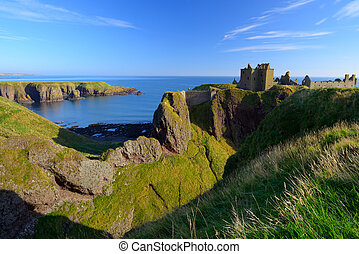 Dunnottar Castle with blue sky background in Abeedeen,...