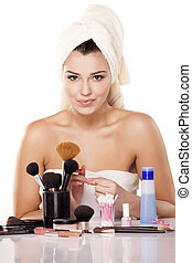 removing a nail polish - smiling girl with towel on head...