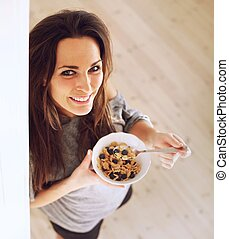 Cheerful Lady Starts the Morning Right by Eating Breakfast -...