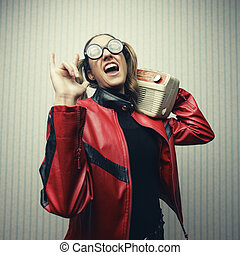 Rock and Roll - Nerdy woman listening to music, rock lover