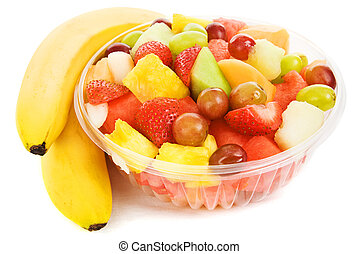 Bowl of Tropical Fruit - Bowl of tropical fruit beside two...